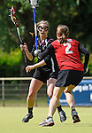 GER - Hannover, Germany, May 30: During the Women Lacrosse Playoffs 2015 match between SCC Blax Berlin (red) and KIT SC Karlsruhe (black) on May 30, 2015 at Deutscher Hockey-Club Hannover e.V. in Hannover, Germany. Final score 17:7. (Photo by Dirk Markgraf / www.265-images.com) *** Local caption *** Laura Roesberg #5 of KIT SC Karlsruhe, Franziska Luhn #2 of SCC Blax