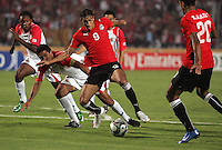Egypt's Mohamed Talaat (9) fights off the Costa Rican team during the FIFA Under 20 World Cup Round of 16 match between Egypt and Costa Rica at the Cairo International Stadium on October 06, 2009 in Cairo, Egypt.