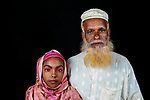 Pictured: Tasnim and her grandfather Shukur Mia <br /> <br /> Family members with an unusual pigmentation show off their shockingly bright, blue eyes.  Eyes of this colour are rare for people of a darker skin tone, and the cause is a lack of melanin pigment in the iris of the eye.<br /> <br /> Lower levels of melanin are more commonly found in people with lighter skin tones, meaning they are more likely to have lighter coloured eyes.  The grandfather's name is Shukur Mia, who is photographed with his granddaughter Tasnim, 11, and grandson Mehedi, 6.  SEE OUR COPY FOR DETAILS.<br /> <br /> Please byline: Sultan Ahmed Niloy/Solent News<br /> <br /> © Sultan Ahmed Niloy/Solent News & Photo Agency<br /> UK +44 (0) 2380 458800