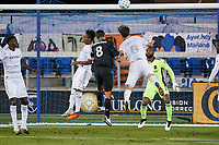 SAN JOSE, CA - NOVEMBER 4: Chris Wondolowski #8 of the San Jose Earthquakes goes up for a header with Latif Blessing #7 and Francisco Ginella #8 of LAFC during a game between Los Angeles FC and San Jose Earthquakes at Earthquakes Stadium on November 4, 2020 in San Jose, California.