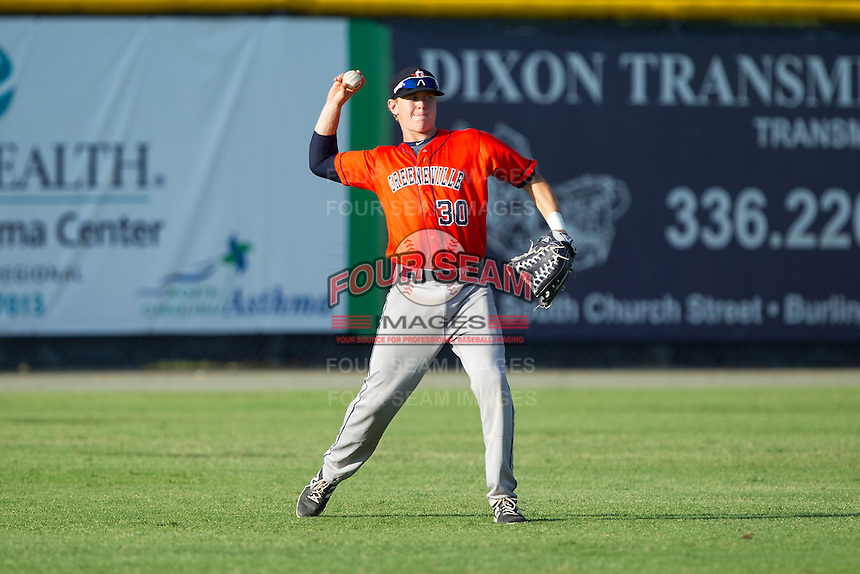 Greeneville Astros left fielder Trent Woodward (30) throws the ball back to the infield during the game against the Burlington Royals at Burlington Athletic Park on June 29, 2014 in Burlington, North Carolina.  The Royals defeated the Astros 11-0. (Brian Westerholt/Four Seam Images)