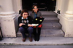Andrew Lloyd Webber and Sarah Hugill his first wife sitting on the steps of their London home in Eaton Place. Sarah with a Cats Musical promotional material. 1981