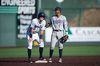 Everett AquaSox left fielder Charlie McConnell (19) laughs with Kelvin Alarcon (1) during a Northwest League game against the Tri-City Dust Devils at Everett Memorial Stadium on September 3, 2018 in Everett, Washington. The Everett AquaSox defeated the Tri-City Dust Devils by a score of 8-3. (Zachary Lucy/Four Seam Images)
