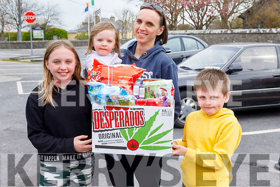 Danielle Fitzmaurice with her children Naoise, Mia and Averi making a donation to the St Brendans hurling and Ardfert football clubs appeal for donations to the staff of UHK in Ardfert on Friday.