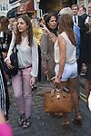 Motcomb Street Belgravia London UK. Summer Street Party . Woman wearing hot pants