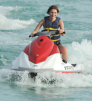 """SMG_FLXX_Mischa Barton_Jet Skiing_010212_04.JPG<br /> <br /> MIAMI BEACH, FL - JANUARY 2 :  Actress Mischa Barton goes jet skiing with red lipstick on her teeth  along with an unidentified man In Miami.  Mischa Anne Marsden Barton (born 24 January 1986) is a British-American fashion model, film, television, and stage actress. She began her acting career on the stage, appearing in Tony Kushner's Slavs! And took the lead in James Lapine's Twelve Dreams at New York's Lincoln Center. She made her screen debut, making a guest appearance on the American soap opera All My Children (1996). She then voiced a character on KaBlam! (1996-1997), an animated television series on Nickelodeon. Her first major film role was as the protagonist of Lawn Dogs (1997), an acclaimed drama co-starring Sam Rockwell. In 1997, she also landed a Calvin Klein campaign. She continued acting, appearing in major box office pictures such as the romantic comedy, Notting Hill (1999) and M. Night Shyamalan's psychological thriller, The Sixth Sense (1999). She later appeared in the independent drama, Lost and Delirious (2001) and played Evan Rachel Wood's girlfriend during a guest-arc on ABC's Once and Again (2001-2002). She is best known for her role as Marissa Cooper in the Fox television series The O.C. (2003-2006), for which she received two Teen Choice Awards and a Prism Award nomination. Entertainment Weekly named her the """"It Girl"""" of 2003.  On December 27, 2011 in Miami Beach, Florida   On January 02, 2012 in Miami Beach, Florida  (Photo By Storms Media Group)   <br /> <br /> People:  Mischa Barton<br /> <br /> Transmission Ref:  FLXX<br /> <br /> Must call if interested<br /> Michael Storms<br /> Storms Media Group Inc.<br /> 305-632-3400 - Cell<br /> 305-513-5783 - Fax<br /> MikeStorm@aol.com"""