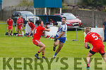 Bryan Sheehan for St Marys easily brushes aside the Challenge from Waterville's Oran Clifford and continues to dictate the movement of play from mid-field to the forwards.