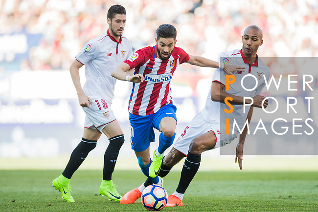 Yannick Ferreira Carrasco (c) of Atletico de Madrid is challenged by Pablo Sarabia Garcia (l) and Steven N'Kemboanza Mike N'Zonzi (r) of Sevilla FC during their La Liga match between Atletico de Madrid and Sevilla FC at the Estadio Vicente Calderon on 19 March 2017 in Madrid, Spain. Photo by Diego Gonzalez Souto / Power Sport Images