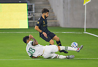 LOS ANGELES, CA - SEPTEMBER 13: Bill Tuiloma #25 of the Portland Timbers defends against Brian Rodriguez #17 of LAFC during a game between Portland Timbers and Los Angeles FC at Banc of California stadium on September 13, 2020 in Los Angeles, California.