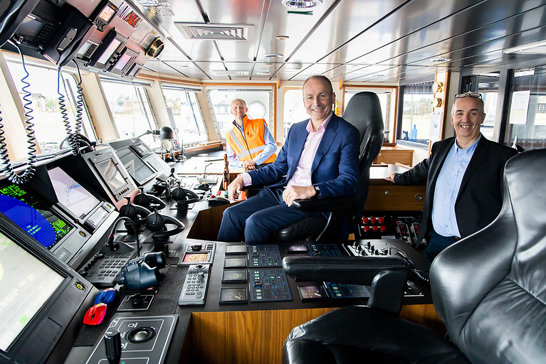 Taoiseach Micheal Martin joins John Wallace, Green Rebel CEO and Chris Franks, Senior Master of the Roman Rebel on board the Roman Rebel for the announcement that Green Rebel is to create 50 jobs over the next year