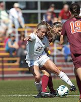Tightly defended Boston College defender McKenzie Meehan (22) dribbles. Virginia Tech defender Danielle King (8).Virginia Tech (maroon) defeated Boston College (white), 1-0, at Newton Soccer Field, on September 22, 2013.