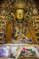 Nepal, Kathmandu, Swayambhunath.  Buddha and Cash Donations.