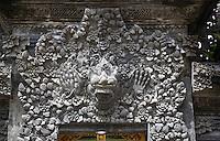 Jatiluwih, Bali, Indonesia.  Hindu Deity Kala above Exit from Inner Courtyard, Luhur Bhujangga Waisnawa Hindu Temple.