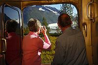 Passengers view Spencer Glacier from the Alaska Railroad Glacier Discovery Train, Chugach National Forest, Alaska.