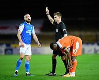 Peterborough United's Dan Butler is shown a yellow card by referee Ollie Yates<br /> <br /> Photographer Chris Vaughan/CameraSport<br /> <br /> The EFL Sky Bet League One - Peterborough United v Blackpool - Saturday 21st November 2020 - London Road Stadium - Peterborough<br /> <br /> World Copyright © 2020 CameraSport. All rights reserved. 43 Linden Ave. Countesthorpe. Leicester. England. LE8 5PG - Tel: +44 (0) 116 277 4147 - admin@camerasport.com - www.camerasport.com