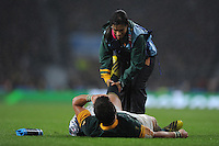 Handre Pollard of South Africa is checked over by a medic but later leaves the pitch during the Semi Final of the Rugby World Cup 2015 between South Africa and New Zealand - 24/10/2015 - Twickenham Stadium, London<br /> Mandatory Credit: Rob Munro/Stewart Communications