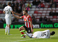 SUNDERLAND, ENGLAND - MAY 13: Matrin Olsson of Swansea City (R) is fouled by Fabio Borini of Sunderland for which he saw a yellow card during the Premier League match between Sunderland and Swansea City at the Stadium of Light, Sunderland, England, UK. Saturday 13 May 2017