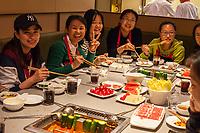Nanjing, Jiangsu, China.  Friends Having Lunch Together in a Restaurant.