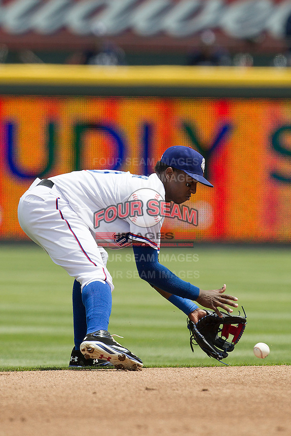 Round Rock Express shortstop Jurickson Profar #10 fields a ground ball in the first inning of the Pacific Coast League baseball game against the New Orleans Zephyrs on April 21, 2013 at the Dell Diamond in Round Rock, Texas. Round Rock defeated New Orleans 7-1. (Andrew Woolley/Four Seam Images).