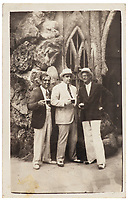 BNPS.co.uk (01202 558833)<br /> Pic: SheldonCarpenter/Witherell'sInc/BNPS<br /> <br /> Pictured: A vintage silver print photograph of Al Capone (centre) in Havana, Cuba.<br /> <br /> An incredible treasure trove of Al Capone heirlooms have sold at auction for a whopping £2.3m. ($3.1m)<br /> <br /> The star lot was the notorious American gangster's favourite gun - a 1911 Colt semi-automatic pistol, which was expected to fetch £110,000 but sold for an incredible £764,000. ($1.04m)<br /> <br /> The remarkable collection, sold by his granddaughters, included personalised jewellery, photographs and furniture and a letter written to his only child Sonny from Alcatraz Prison, which showed a tender side to the ruthless crime boss.