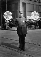 Traffic policeman using 4th Liberty Loan fans for signals.  St. Louis, 1918.  The Schreiber Co. (Bureau of Public Debt)<br /> Exact Date Shot Unknown<br /> NARA FILE #:  053-LL-12-1<br /> WAR & CONFLICT BOOK #:  522