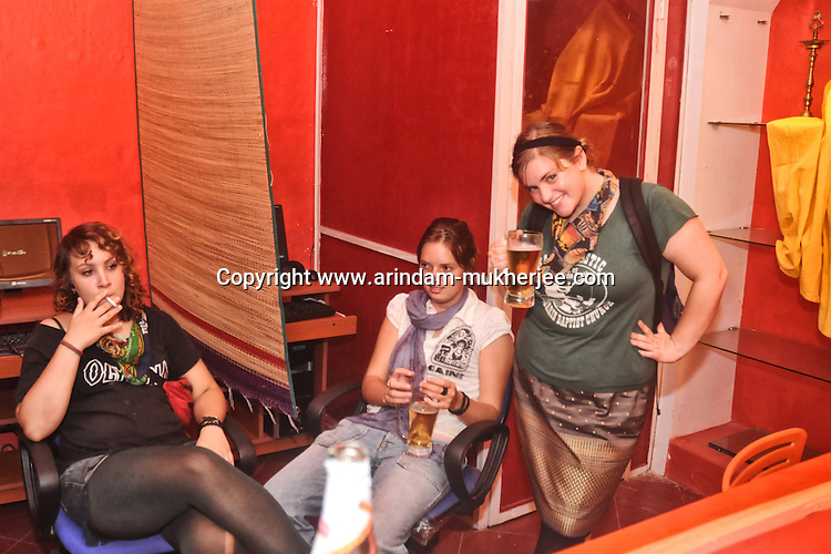 Western tourists in a party mood at a cyber cafe during mid night in Pondicherry. Arindam Mukherjee