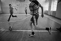 """Nagorny-Karabach, 11.05.2011, Shushi. Ein Gruppe junger Fussballer trainiert in der frisch renovierten Sporthalle in Schuschi. """"The Twentieth Spring"""" - ein Portrait der s¸dkaukasischen Stadt Schuschi, 20 Jahre nach der Eroberung der Stadt durch armenische K?mpfer 1992 im B¸gerkrieg um die Unabh?ngigkeit Nagorny-Karabachs (1991-1994). A group of young soccers is playing in Shushis new renovated sports hall. """"The Twentieth Spring"""" - A portrait of Shushi, a south caucasian town 20 years after its """"Liberation"""" by armenian fighters during the civil war for independence of Nagorny-Karabakh (1991-1994). .Un groupe de jeunes joue au foot dans la nouvelle salle de sport de Shushis.""""Le Vingtieme Anniversaire » - Un portrait de Chouchi, une ville du Caucase du Sud 20 ans après sa «libération» par les combattants arméniens pendant la guerre civile pour l'indépendance du Haut-Karabakh (1991-1994)..© Timo Vogt/Est&Ost, NO MODEL RELEASE !!"""