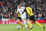 Theo Hernandez of Real Madrid (C) fights for the ball with Borussia Dortmund Midfielder Christian Pulisic (L) during the Europe Champions League 2017-18 match between Real Madrid and Borussia Dortmund at Santiago Bernabeu Stadium on 06 December 2017 in Madrid Spain. Photo by Diego Gonzalez / Power Sport Images