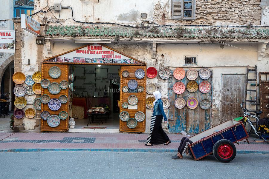 Essaouira, Morocco.  Ceramics Shop, Porter Resting in his Cart, Avenue de l'Istiqlal