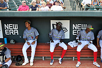 Columbia Fireflies players Mark Vientos (13), Ronny Mauricio (2), and Shervyen Newton (3) sit in the dugout before a game against the Charleston RiverDogs on Friday, July 12, 2019 at Segra Park in Columbia, South Carolina. The RiverDogs won, 4-3 in 10 innings. (Tom Priddy/Four Seam Images)