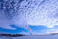 FOUNTAIN GEYSER PRODUCES LOTS OF STEAM TO AFFECT THE SKY ABOVE DURING WINTER IN YELLOWSTONE NATIONAL PARK,WYOMING