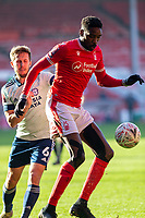 9th January 2021; City Ground, Nottinghamshire, Midlands, England; English FA Cup Football, Nottingham Forest versus Cardiff City; Sammy Ameobi of Nottingham Forest controls the ball as Will Vaults of Cardiff City comes in to tackle
