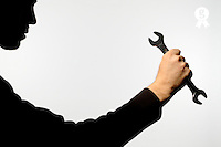 Silhouette of man holding wrench (Licence this image exclusively with Getty: http://www.gettyimages.com/detail/sb10068346bl-001 )