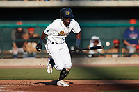 Osleivis Basabe (9) of the Charleston RiverDogs lays down a bunt against the Down East Wood Ducks at Joseph P. Riley, Jr. Park on September 26, 2021 in Charleston, South Carolina. (Brian Westerholt/Four Seam Images)