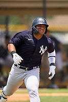 FCL Yankees Jasson Dominguez (25) runs to first base during a game against the FCL Tigers on June 28, 2021 at Tigertown in Lakeland, Florida.  (Mike Janes/Four Seam Images)