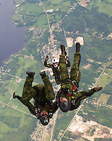 Cpl. Corey Douglas, centre, jumps with teammates MCpl. Adam Winnicki, left, and Sgt. Real Baril as the SkyHawks, the Canadian Forces parachute team, do a practice jump in Petawawa, Ont., on Friday, June 10, 2011. This year is the SkyHawks 40th anniversary season. THE CANADIAN PRESS/Sean Kilpatrick