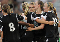 BOYDS, MARYLAND-JULY 07,2012:  Players of of DC United Women congratulate Andi Sullivan (24) after she scored the third goal against the Dayton Dutch Lions during a W League game at Maryland Soccerplex, in Boyds, Maryland. DC United women won 4-1.