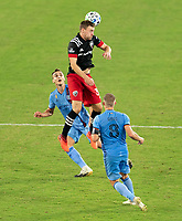 WASHINGTON, DC - SEPTEMBER 06: Julian Gressel #31 of D.C. United heads the ball during a game between New York City FC and D.C. United at Audi Field on September 06, 2020 in Washington, DC.