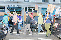 """Protestors march along Tremont Street as they make their way to Boston City Hall during the 2020 Women's March protest in opposition to the re-election of US president Donald Trump in Boston, Massachusetts, on Sat., Oct. 17, 2020.<br /> The sign here reads """"Fight like a girl,"""" and features an image of Supreme Court Justice Ruth Bader Ginsburg wearing a crown."""