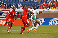 Panama defender Felipe Baloy (23), defender Eduardo Dasent (14) and Guadeloupe forward Richard Socrier (21) during the CONCACAF soccer match between Panama and Guadeloupe at Ford Field Detroit, Michigan.