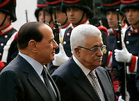 Il Presidente del Consiglio Silvio Berlusconi, sinistra, accoglie il Presidente dell'Autorita' Nazionale Palestinese Mahmoud Abbasa Palazzo Chigi, Roma, 7 ottobre 2009..Italian Premier Silvio Berlusconi, left,  welcome Palestinian President Mahmoud Abbasat Chigi Palace, Rome, 7 october 2009..UPDATE IMAGES PRESS/Riccardo De Luca