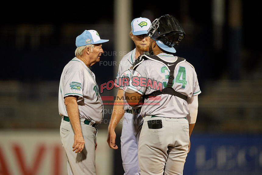 Daytona Tortugas pitching coach Tom Brown (8) talks with relief pitcher John Ghyzel (18) and catcher Hendrik Clementina (34) during a Florida State League game against the Tampa Tarpons on May 18, 2019 at George M. Steinbrenner Field in Tampa, Florida.  Daytona defeated Tampa 7-6.  (Mike Janes/Four Seam Images)