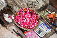 Fatehpur Sikri, Uttar Pradesh, India.  A Basket of Rose Petals  sits by the Entrance to  the Mausoleum of Sheikh Salim Chishti.  Visitors sprinkle petals on the tomb.