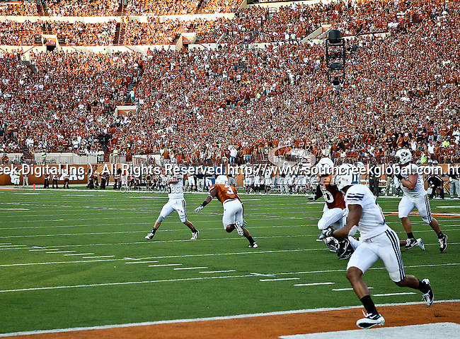 Brigham Young Cougars quarterback Jake Heaps (9) and Texas Longhorns linebacker Jordan Hicks (3) in action as the fans watch during the game between the Brigham Young Cougars and the Texas Longhorns at the Darrell K Royal - Texas Memorial Stadium in Austin, Texas. Texas defeats Brigham Young 17 to 16...