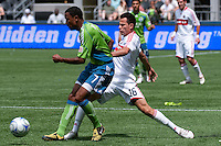 James Riley (7) of the Seattle Sounders fights with Marco Pappa (16) of the Chicago Fire in the match at the XBox Pitch at Quest Field on July 25, 2009. The Sounders and Fire played to a 0-0 draw.