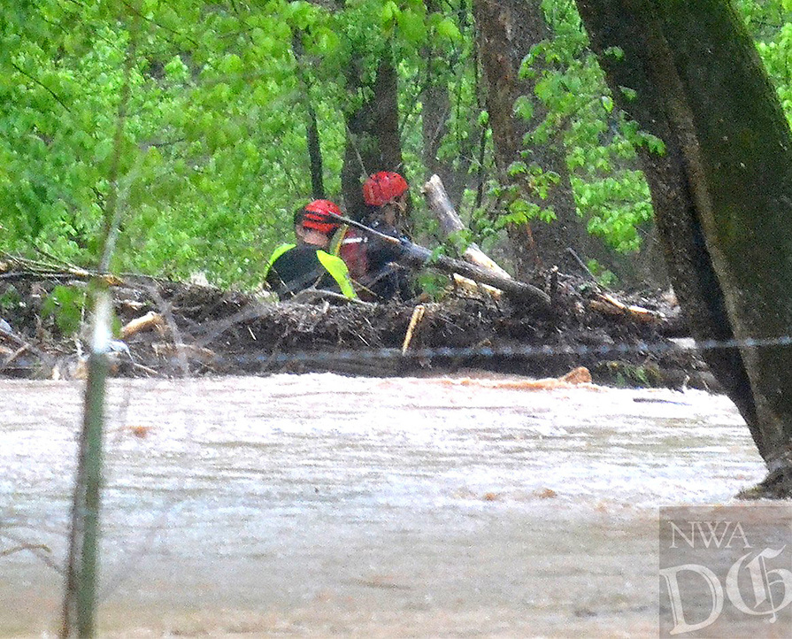 Two water rescue personnel from assisted Little FLock in rescuing John Adams III from the flood waters on Rustic Drive in Little Flock Wednesday morning.<br /> (Pea Ridge Times/Annette Beard)