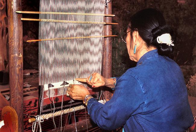 Navajo weaver, Nanabah, demonstrates weaving of a traditional Navajo wool rug in Salt Lake City Utah