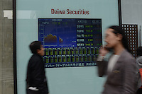 TV SCREEN SHOWS STOCK EXCHANGE RATE AT DAIWA SECURITIES IN SHIBUYA, TOKYO