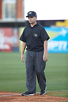 Umpire Josh Gilreath handles the calls on the bases during the the South Atlantic League game between the Hagerstown Suns and the Greensboro Grasshoppers at First National Bank Field on April 6, 2019 in Greensboro, North Carolina. The Suns defeated the Grasshoppers 6-5. (Brian Westerholt/Four Seam Images)
