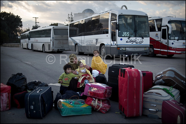 © Remi OCHLIK/IP3 -   RA'AS AJADIR, Tunisian and Libyan border, Feb. 24 -- Hundreds of Egyptian workers gather in bus to leave the border to the Choucha refugees camp..Thousands of people fleeing the violence and insecurity in neighboring Libya are crossing the Tunisian border at the Ras El Jedir cross point some 600 km south of the capital. Around 2,500 people cross the border every 6 minutes, putting a strain on the efforts of the Tunisian Red Crescent to cater for the migrants, some of whom have covered long distances to reach the border, said the report...Medical and paramedical teams are manning a newly set-up military hospital and the local bus company is providing free transportation to the neighboring city of Ben Guerdane, aided by a number of volunteers who are ferrying the migrants away from the border to avoid congestion, according to the report...An emergency convoy composed of medicine and foodstuff was dispatched in aid to the Libyan people to Ras El Jedir on Wednesday evening and several hospitals and hostels are preparing to look after the increasing number of Libyan migrants who are fleeing the violence in their country, the report added.